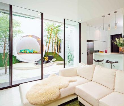 desain-rumah-gaya-zen-pada-ruang-tamu-dengan-taman